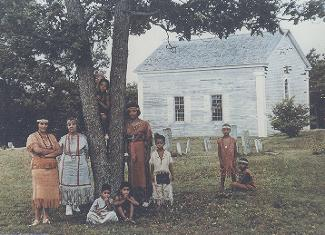 Photo of Wampanoag family in the yard of the mashpee old Meting House circa 1959.